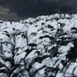 Stock Video: Aerial View of Volcanic Dust Layer on Glaciers
