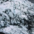 Stock Video: Aerial View of an Icelandic Glacier & Volcanic Dust