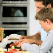 Caucasian Family Preparing Healthy Meal Together - Stock Photo