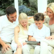 Young Caucasian Family Using Wireless Tablet — Stock Video #23258910