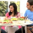 Young Asian Family Sharing Healthy Lunch Together — Stock Video #23259072