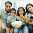 Young Asian family Watching TV with Popcorn — Stock Video #23259226
