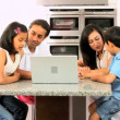 Young Asian Family Using Laptop in Kitchen — Stock Video #23259408