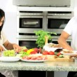Asian Family Preparing Healthy Meal Together - Stock Photo