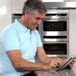 Mature Couple & Success on a Wireless Tablet — Stock Video #23259870