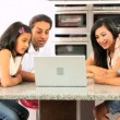 Stock Video: Young Ethnic Family Using Laptop for Webchat