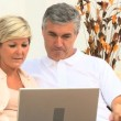 Stock Video: Middle Aged Couple Using Online Webchat at Home