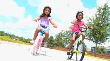 Little African American Girls on Bicycles — Stock Video