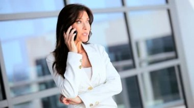 Female Caucasian Business Executive with Smartphone — Stock Video