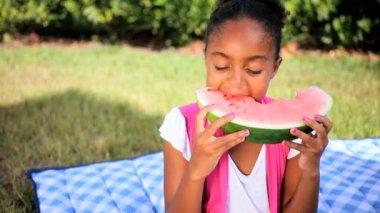 Little African American Girl Eating Fresh Fruit — Stock Video