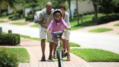Little African American Girl Learning to Ride a Bike — Stock Video