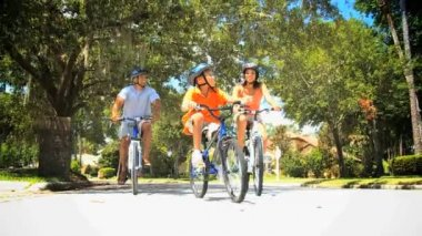 Young Ethnic Family Keeping Fit Cycling Together — Stock Video
