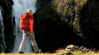 Young Female on Hiking Expedition by Waterfall — Stock Video
