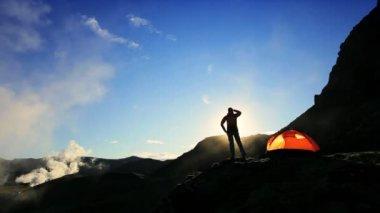 Female Climber Watching Sunrise — Stock Video