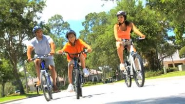 Healthy Ethnic Family Cycling Together — Stock Video