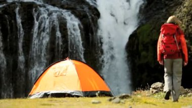 Hiker & Her Tent by Cascading Waterfall — Stock Video