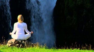 Girl Practising Yoga by Waterfall — Stock Video
