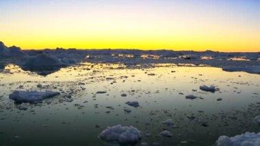 Sun Setting over Glacaial Ice — Stock Video
