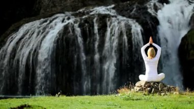 Yoga Exercises at Flowing Waterfall — Stock Video