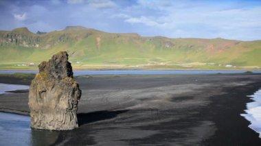 Lone Figure Watching Arctic Waves & Volcanic Ash Beach — Stock Video