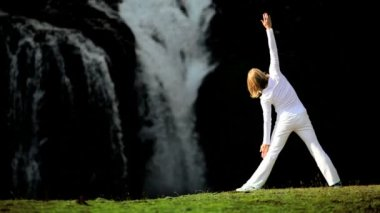 Girl Practising Yoga by Waterfall — Stock Video