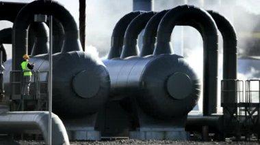 Female Geothermal Engineer Recording Data — Stock Video