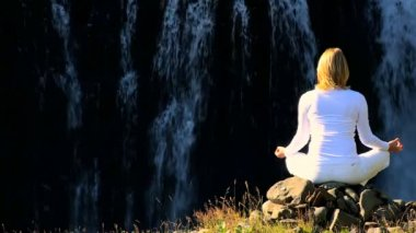 Female Practising Yoga by Waterfall — Stock Video
