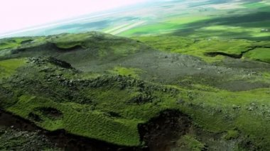 Aerial View of Rugged Icelandic Volcanic Ridges & Grasslands — Stock Video