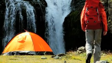 Lone Female Hiker by Tent at Waterfall — Stock Video