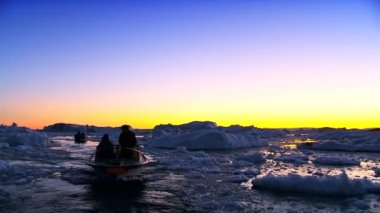 Vessels at Sunset in Ice Floes with Icebergs — Stock Video