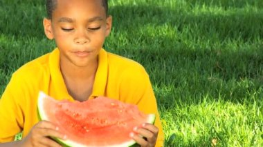 African American Child Eating Refreshing Water Melon — Stock Video
