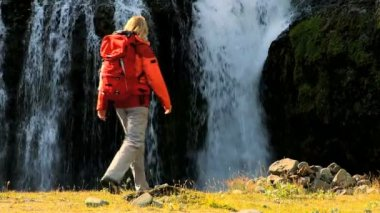 Female Hiker Stopping at Waterfall — Stock Video
