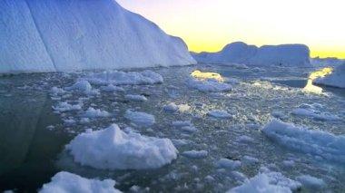 Sun Setting over Icebergs — Stock Video
