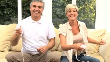 Middle Aged Caucasian Couple Playing on Games Console — Stock Video