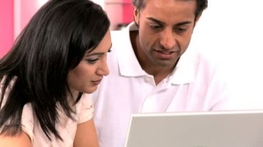 Young Ethnic Couple Online with Wireless Laptop — Stock Video