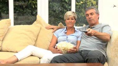 Mature Caucasian Couple Enjoying TV & Popcorn — Stock Video