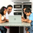 Asian Family in Kitchen with Laptop Computer — Stock Video