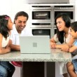 Young Ethnic Family with Laptop in Kitchen — Stock Video