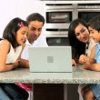 Young Ethnic Family Using Laptop for Webchat — Stock Video
