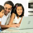Young Ethnic Father & Children Using Laptop in Kitchen — Stock Video