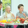 Attractive Young Family Enjoying a Healthy Meal — Stock Video #23260984