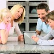 Young Caucasian Family Using Wireless Tablet — Stock Video