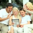 Caucasian Family Using Online Video Chat with Relatives - Stock Photo
