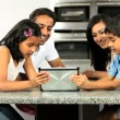 Young Asian Family Using Wireless Tablet — Stock Video #23261218
