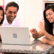 Young Ethnic Family Using Laptop for Webchat — Stock Video #23261344