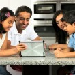 Young Ethnic Family with Wireless Tablet in Kitchen — Stock Video #23261366
