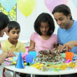 Stock Video: Young Asian Children Enjoying Birthday Cake