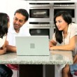 Asian Family in Kitchen with Laptop Computer — Stock Video #23261676