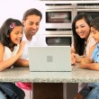 Asian Family Using Laptop for Online Video Chat — Stock Video #23261826