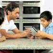 Young Ethnic Family Using Laptop for Webchat — Stock Video #23261834